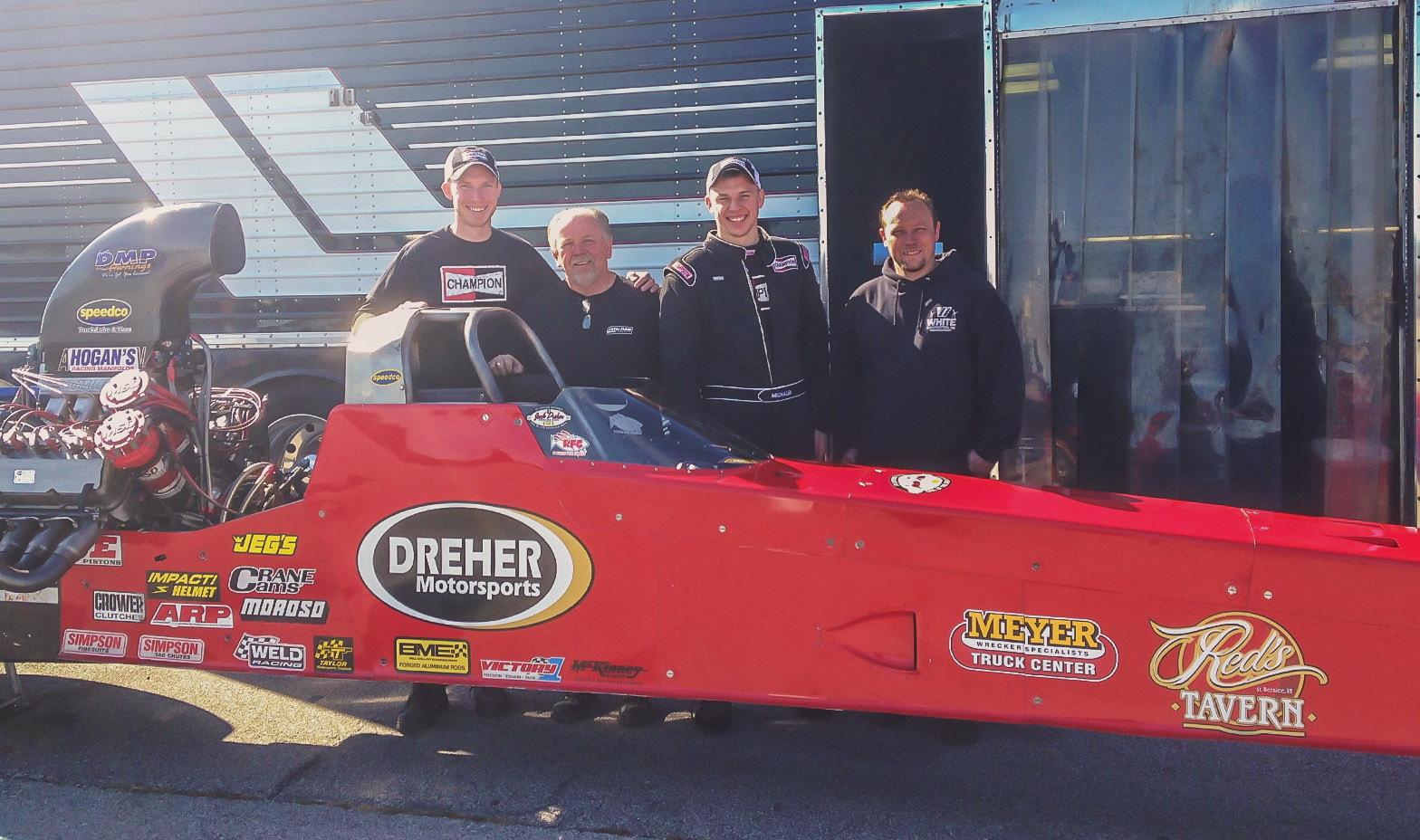 Kyle and Corey stand with car owners Randy and Jared Dreher after Corey completed his license upgrade to an A/fuel dragster