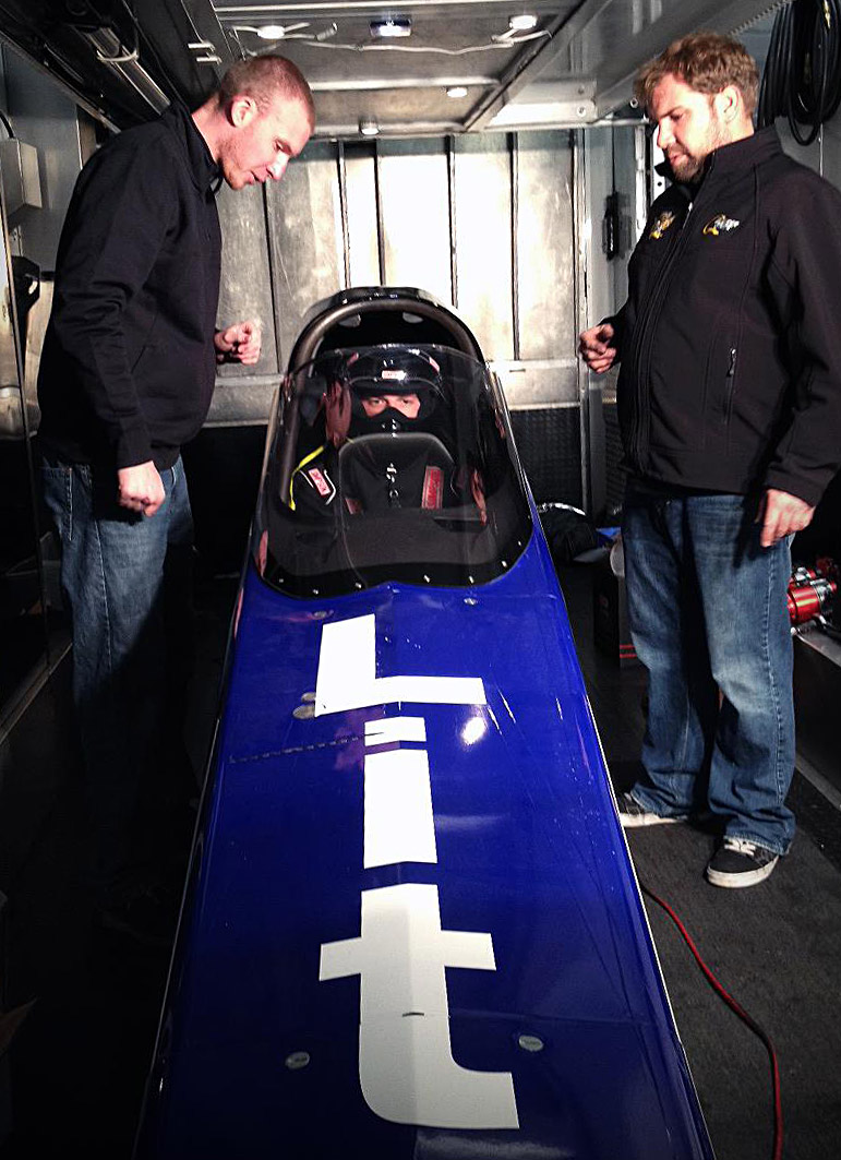 Michalek Brothers Racing driver Kyle Michalek and car owner Anthony Dicero walk Corey through the driving procedure of a 3,500 horsepower A/fuel dragster.
