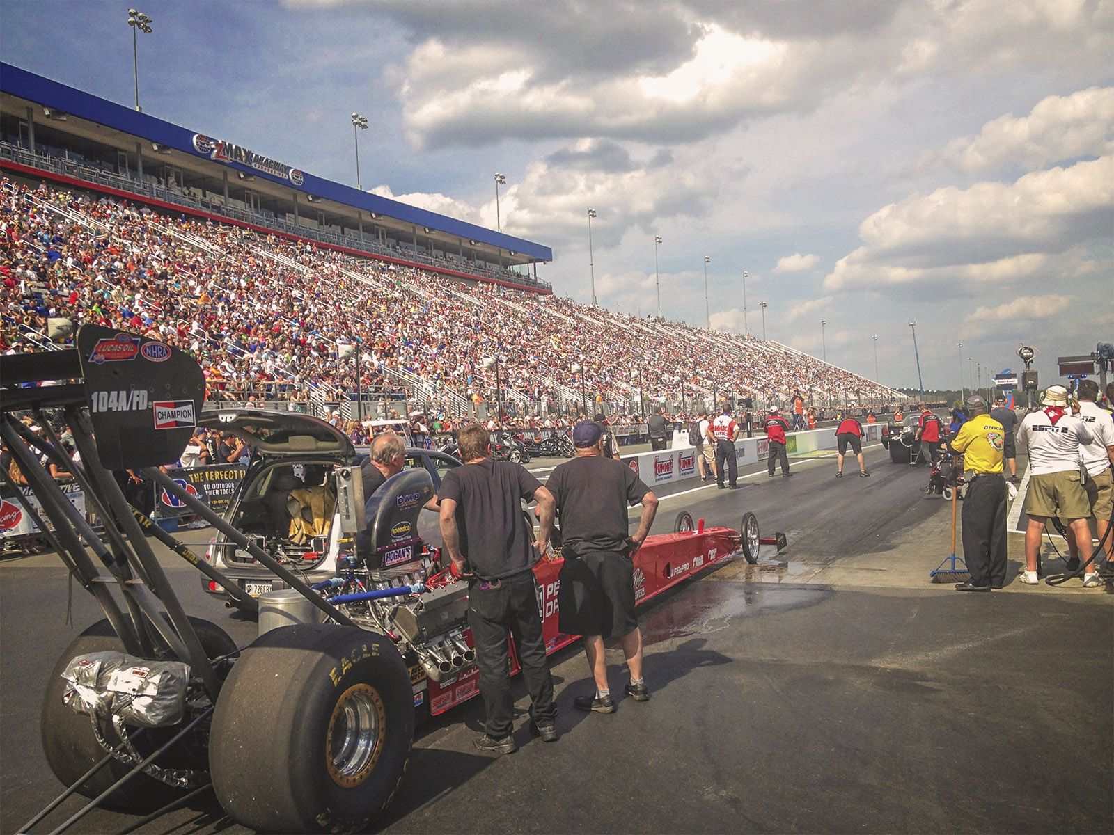 Corey Michalek patiently awaits the final round inside the Champion Spark Plugs / Dreher Motorsports A/fuel dragster in front of a packed house at ZMax Dragway.