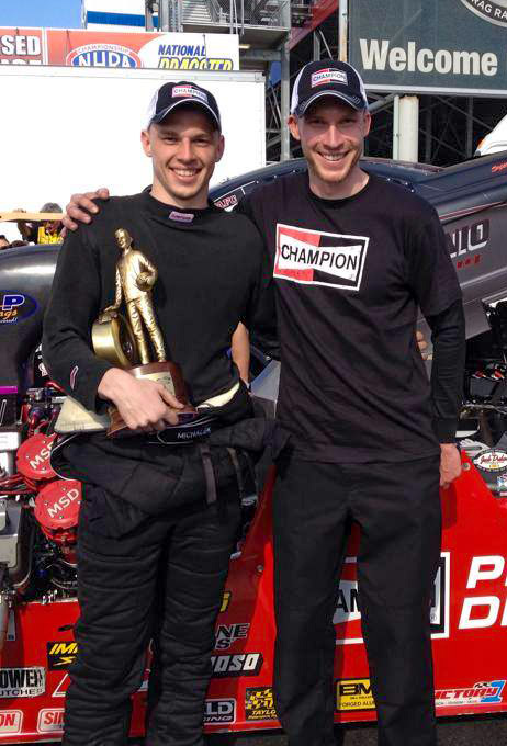 Kyle and Corey celebrate the victory in the staging lanes with their first Wally trophy.