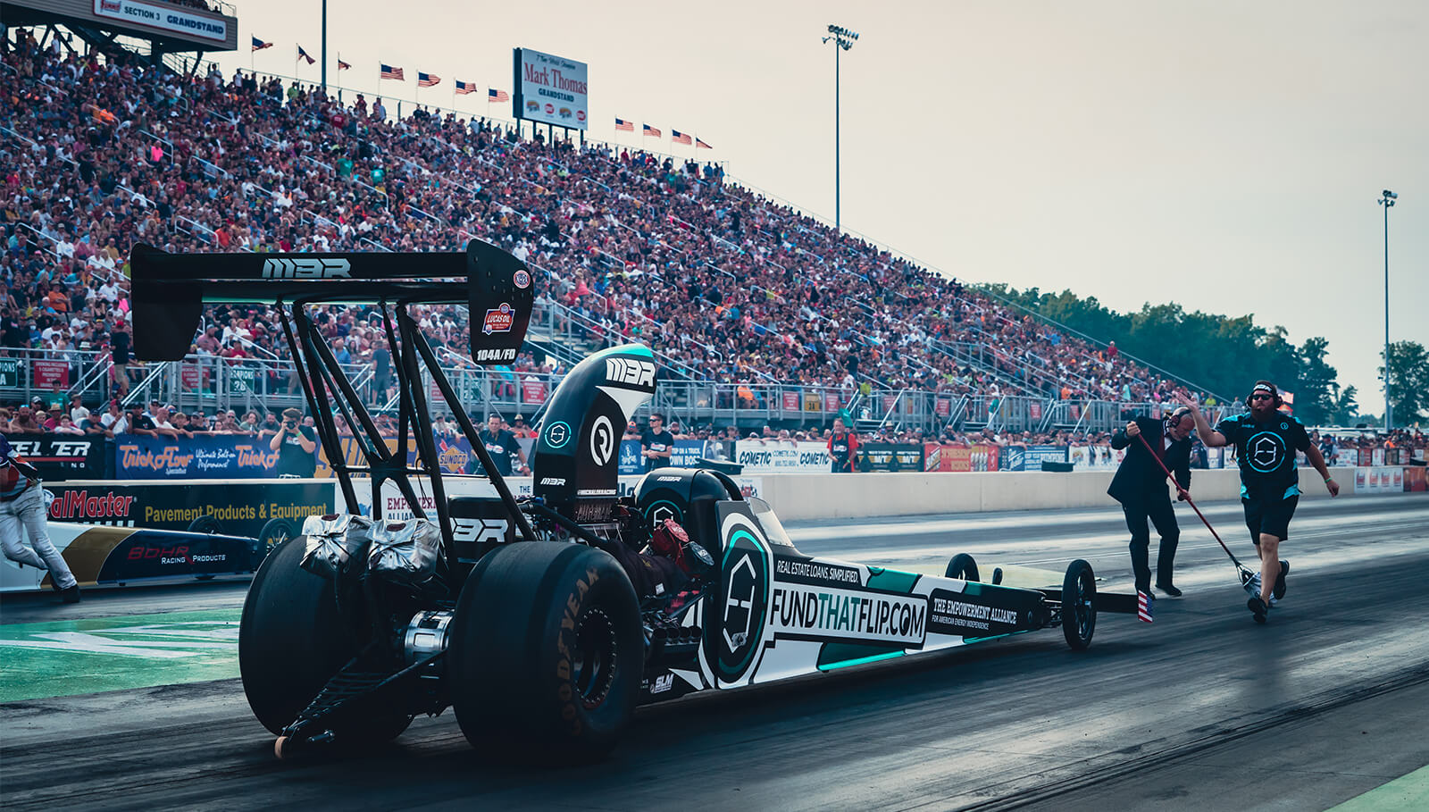 The Fund That Flip / Empowerment Alliance A/fuel dragster was on display in front of over 50,000 people at the 44th running of the Kelly Services Night Under Fire.